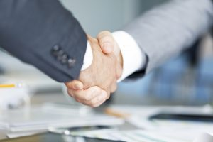 Two businessman shaking hands, copy space